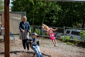 Kids swinging on the playground at Community Preschool.