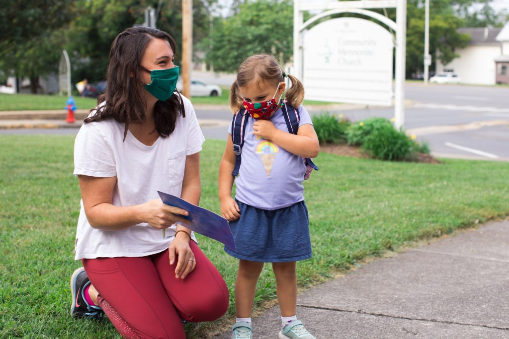A parent drops off her daughter at Community Preschool in Harrisonburg, Virginia.